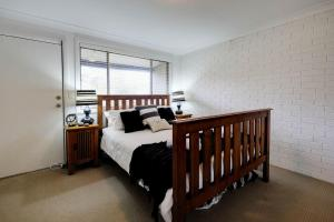 A bed or beds in a room at @THE COVE