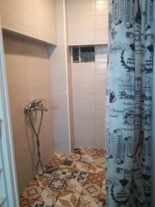 A bathroom at Aphrodite Boutique Hotel