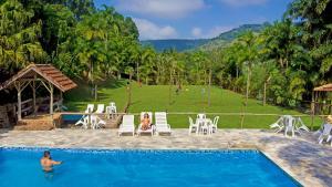 The swimming pool at or near Pousada Cachoeiras da Furna