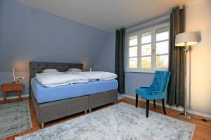 Ein Bett oder Betten in einem Zimmer der Unterkunft Ferienwohnung im Blauen Haus