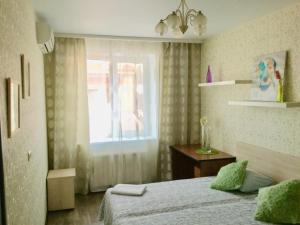 A bed or beds in a room at Apartment in the Heart of Kazan
