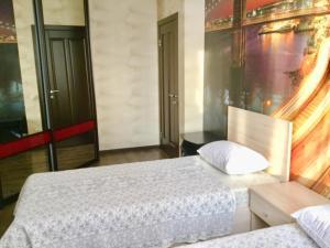 Кровать или кровати в номере Апартаменты в самом сердце Казани
