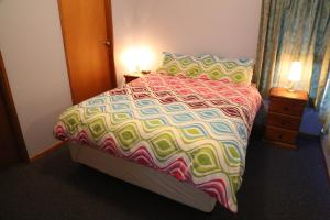 A bed or beds in a room at Nettin View 4