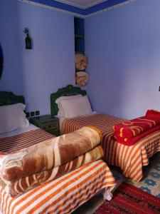 A bed or beds in a room at Hôtel Koutoubia