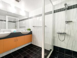 A bathroom at Victoria Square Apartments in the Heart of Broadbe