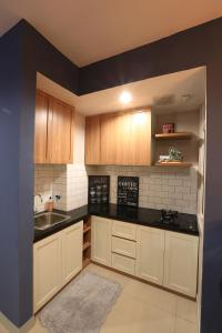 A kitchen or kitchenette at TravelNest @ Kamala Lagoon