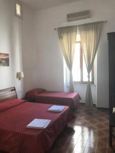 Ein Bett oder Betten in einem Zimmer der Unterkunft Vertex Suite