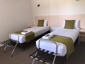 A bed or beds in a room at Glacier Highway Motel
