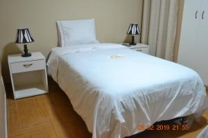 A bed or beds in a room at LUNATENIS