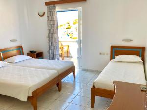 A bed or beds in a room at Lofos Village