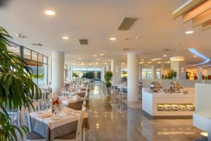 A restaurant or other place to eat at Grand Hotel Holiday Resort