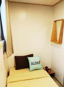 A bed or beds in a room at Lee & No Guesthouse Hongdae