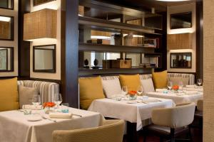A restaurant or other place to eat at Starhotels Excelsior