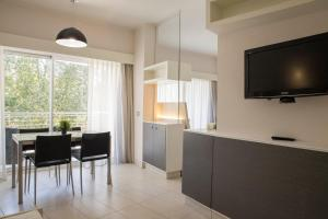 A television and/or entertainment center at Lungotevere Suite