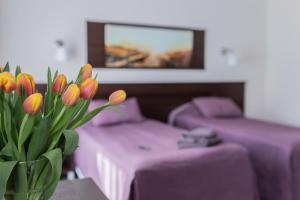 Łóżko lub łóżka w pokoju w obiekcie Villa Nova 34A