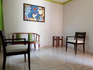 A seating area at Hotel Pousada Beija Flor