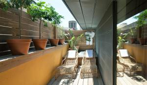A balcony or terrace at Hotel Neri – Relais & Chateaux