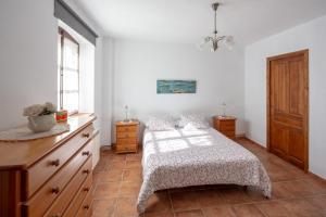 Een bed of bedden in een kamer bij Rincón de piedra BCN