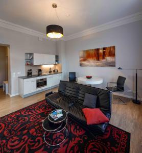 Ein Sitzbereich in der Unterkunft Amalienhof Serviced Apartments