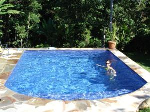 The swimming pool at or near Chale Ilhabela