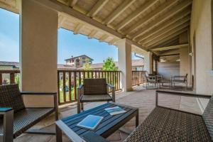 A balcony or terrace at Chervò Golf Hotel Spa, Resort & Apartment San Vigilio
