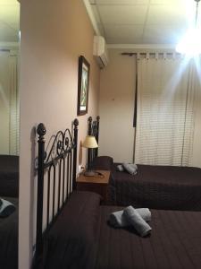 Cama o camas de una habitación en Apartamentos El Silo