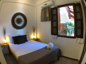 A bed or beds in a room at Villa Guarani Jeri