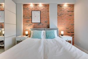 Łóżko lub łóżka w pokoju w obiekcie Comfort Apartments Old Town
