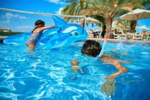 The swimming pool at or near Al Hamra Village