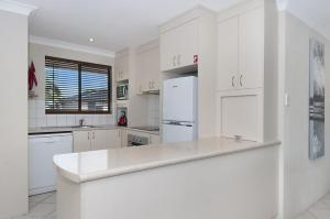 A kitchen or kitchenette at Utopia at Somerset Street