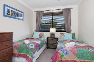 A bed or beds in a room at Utopia at Somerset Street