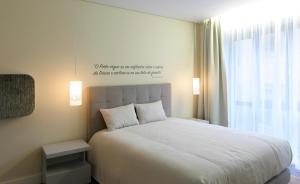 Een bed of bedden in een kamer bij Porto Old Town – Tourism Apartments