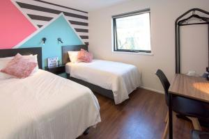 A bed or beds in a room at Brisbane City YHA