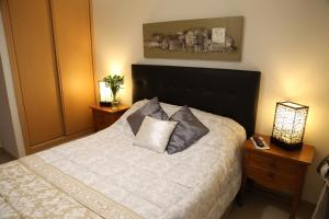 A bed or beds in a room at Conjunto Turístico de Alporchinhos