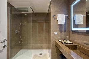 Ein Badezimmer in der Unterkunft Caruso Place Boutique & Wellness Suites