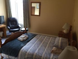 A bed or beds in a room at Camillia Guest House