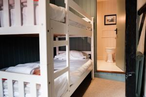 A bunk bed or bunk beds in a room at Bel and The Dragon-Odiham