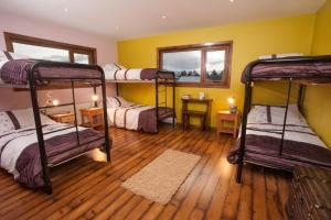 A bunk bed or bunk beds in a room at The Singing Lamb