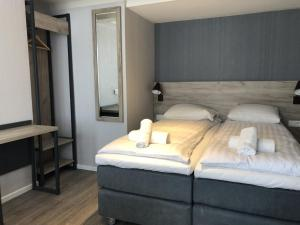 A bed or beds in a room at Facade Hotel Amsterdam