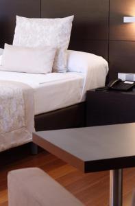 Cama o camas de una habitación en Hotel Palacio de Merás