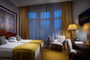 Un ou plusieurs lits dans un hébergement de l'établissement Art Deco Imperial Hotel