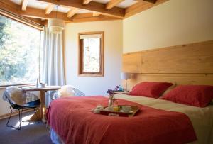 Cama o camas de una habitación en Hotel y Termas Huife
