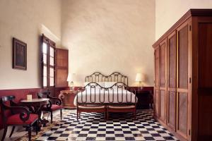 A bed or beds in a room at Hacienda Temozon a Luxury Collection Hotel