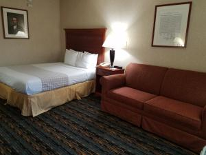 A bed or beds in a room at Best Western Fairfax City