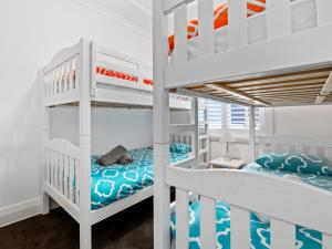 A bunk bed or bunk beds in a room at The Bondi Beach Family Escape