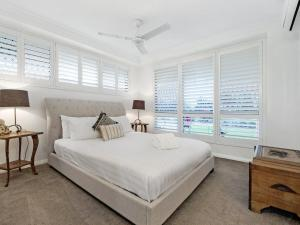 A bed or beds in a room at Victoria Square Apartments Broadbeach - Level 4
