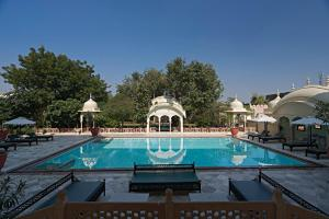 The swimming pool at or near Alsisar Mahal- Heritage Hotel