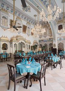 A restaurant or other place to eat at Alsisar Mahal- Heritage Hotel