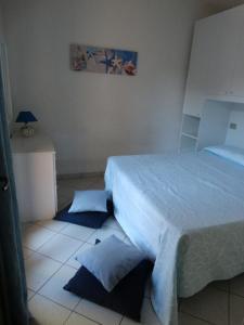 Letto o letti in una camera di Appartamento della Sughereta