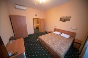 A bed or beds in a room at CSKA Hotel